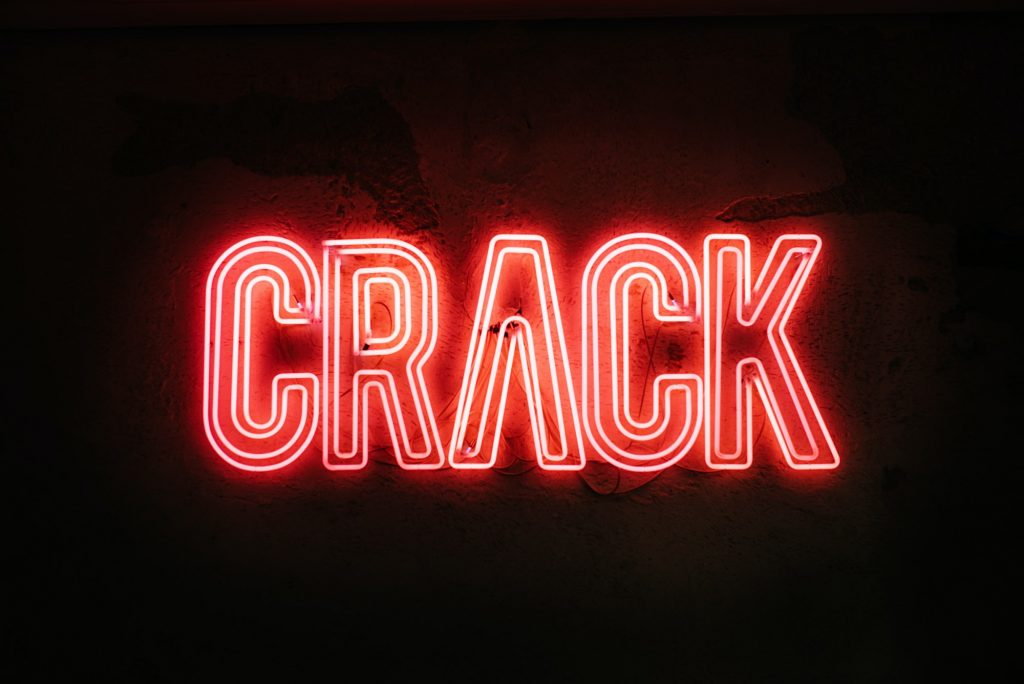 Neon sign on a wall - Crack